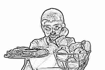Школьник с сладким и фруктами