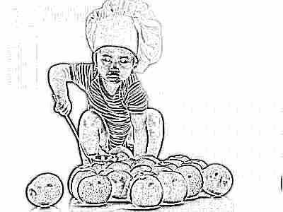 Ребенок играет с яблоками